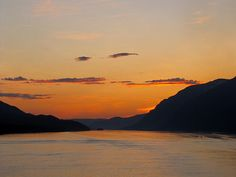 2 Am On The Inside Passage Photography by Phil WelsherDescription: Two o'clock in the morning on the Inside Passage Way near Juneau Alaska. The sun never quite fully set. Instead this is what you saw nearly all night long.