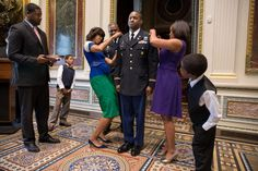 First Lady Michelle Obama participates in a promotion ceremony for White House Fellow...