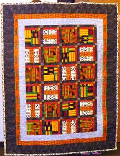A stunning quilt top, made with African fabrics, done by Lynne Johnson.  Father Freddy will love it!