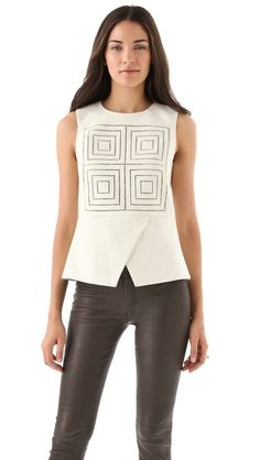 Tibi Eyelet Peplum Top  I really like this shirt even know it's off white.