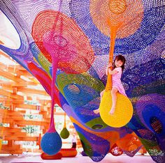 'Lots of people crochet, but how many do you know that order yarn by the ton? Such is the case for Toshiko Horiuchi MacAdam, the artist behind the stunning Rainbow Net playground at the Hakone Sculpture Park in Japan.