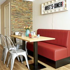 Kitchens: Retro Kitchen with Wall Sign also Red Leather Sofa plus Wooden Dining Table and Metal Dining Chairs