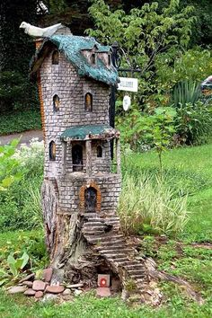 A little house carved out of a tree stump.