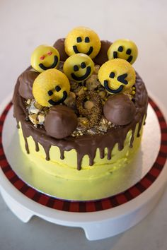 An Emoji Birthday Cake!  The 'Best Ever Chocolate Cake' with a raspberry jam centre, covered in bright yellow buttercream icing, and topped with drizzled milk chocolate.  Toppings include:  crushed crunchie bar, chocolate dipped doughnut holes, oreos and marshmallows (as poop).
