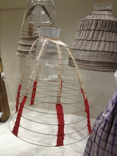 The Crinoline Cage. 1850's-1860's    The Crinoline made it easier for woman to wear fashionable wide skirts ( not having to wear hundreds of petticoat.    The cage is made of metal hoops or cane and supported by fabric or tape.