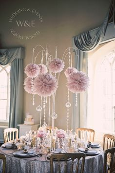 Stunning Dusky Pink Pom Poms with Crystal Droplets & hanging Globe Tea Lights all suspended from our amazing Multi Arm Tablestand centrepieces www.weddingandevents.co.uk North Yorkshire Wedding Flowers