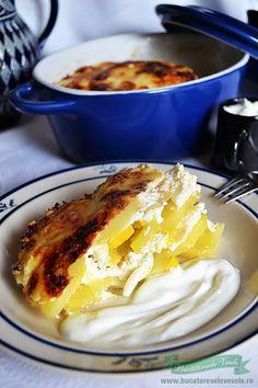 Reteta Cartofi Frantuzesti.Reteta Rakott Krumpli.Preparare Cartofi Frantuzesti.Reteta Cartofi la cuptor.Preparare Cartofi Frantuzesti cu imagini.