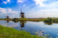 Windmills reflected in canals at Kinderdijk the Netherlands by SergeyBeketov. @go4fotos