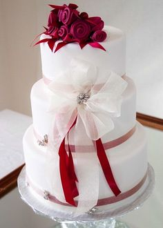 Wedding cake white with red accents, lose the flower on top