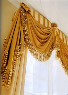 Close up wool curtains-flawlessly made, John Fowler design. Great use of trim.