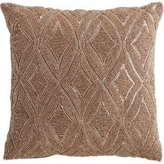 When it comes to decorative pillows, we tend to believe you should go big or go home, as they say. That's the inspiration behind this stunning throw pillow, which is crafted exclusively for Pier 1 with thousands of hand-placed champagne-hued beads covering the front. It shimmers from every angle—making a dazzling impression no matter where you place it.