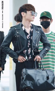 Key looks like a vogue model while one looks like he should be working at a gas station yet they're both two of the greatest idols of all time