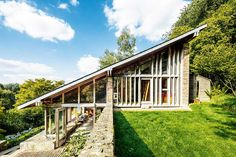A wedge-shaped house: steep pitched roof, 1960s house exterior