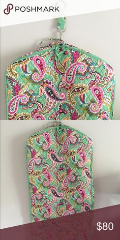 Brand New Vera Bradley Garment Bag This bag has never been used and is in perfect condition. The inside is lined with a pink fabric. Handle at the bottom allows you to fold bag in half. A cute and functional way to travel! Vera Bradley Bags Travel Bags
