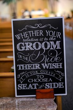 """""""Choose a seat, not a side"""" wedding ceremony sign at a Disney's Fairy Tale Wedding"""