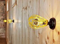 Yellow industrial light cages as DIY lighting fixtures