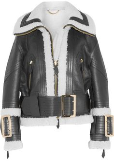 Burberry - Leather-trimmed Shearling Jacket - Black : Burberry's luxurious aviator-style jacket is crafted from smooth black shearling with a plush ecru interior. This oversized style is trimmed with sleek leather straps at the waist and buckled cuffs. Wear yours with everything from jeans to dresses.