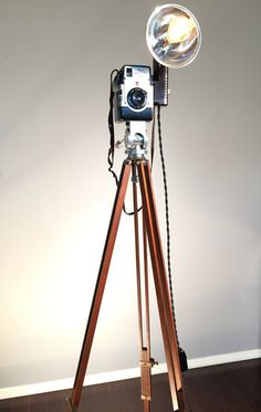 Newly built and listed antique camera tripod lamps.