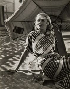 On the Beach: Constance Bennett lounging on the sand at the Beach House.