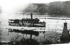 This early spring photograph shows the Majestic passing a river lighthouse. These structures were very important navigation markers on the St. Steam Boats, New Brunswick, The St, Early Spring, Canoe, Lighthouse, Markers, Photograph, Florida