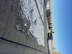 Flat roof replacement with a SBS torch-on onto an industral building in Calgary. The initial assembly was a tar and gravel roof. Flat Roof Replacement, Flat Roof Repair, Bragg Creek, Red Deer, Calgary, June 19, 2 Ply, Building, Industrial