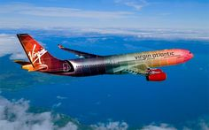25 Amazingly Designed Airplanes. Virgin Atlantic exterior designed by TCH Design Studio. Plane painted like paint swatches