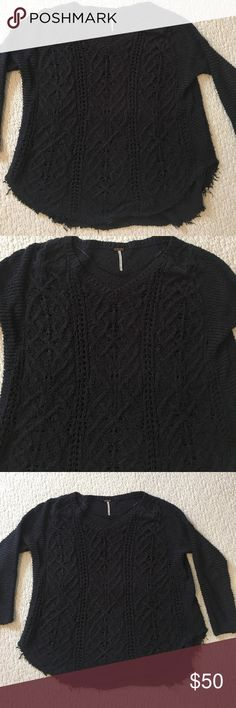 Free People sweater. Size medium. Free People oversized cotton sweater.  V-neck, black cable knit with raw edges. Size medium. Excellent condition only worn twice. Free People Sweaters V-Necks