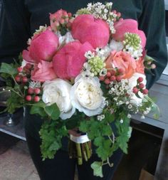 Peonies, garden roses, star of Bethlehem, hypericum berry, and ivy bouquet.
