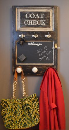 This wall mounted coat rack includes key hooks and magnetic chalkboard! Made from a vintage door, this organizer adds style and function to your entryway.