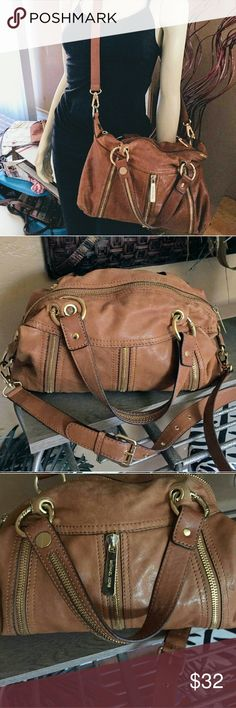 Michael Kors  Handbag Re-Poshing.this lovely tan soft leather purse..  It is in gently used condition.  Was too small for my needs. Approximately 14 X 11, With adjustable detachable shoulder strap  Sold as is,Price Firm. Michael Kors Bags Crossbody Bags
