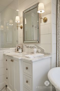 Modern Vintage Bathroom Decor Designs & Ideas For 2020 The key to styling a bathroom with modern vintage design is to choose three major pieces in classic shapes. Accessories complete the modern vintage look. Bathroom Sconces, Bathroom Renos, Bathroom Lighting, Bath Mirrors, Bathroom Remodeling, Shiplap In Bathroom, Gold Mirrors, Houzz Bathroom, Bathroom Vanities