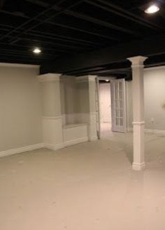 Basement Redo Idea: Exposed black ceiling and finished columns