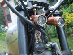 This guide shows you one way to make a pair of high powered LED headlights for your chopper, hog, crotch-rocket, cruiser, scoot, or just plain motorcycle.  The design uses readily available copper fittings for the housing and some bronze threaded rod for the mounting.  Each motorcycle install may be different than that depicted here but the general idea is applicable.  Similar techniques are detailed in some of my other instructables linked below. https://...