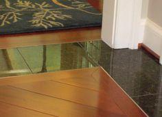Flush tile to wood transition (inset trim).