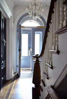 A vintage chandelier graces the entrance hallway.  Jae & Devin's Labor of Love in Brooklyn