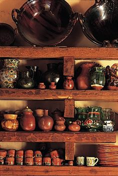 In my dreams, I'd have copper pots and artisan pottery--assuming I'd have the time and patience to keep it all clean. It's my dreams, right? :-)