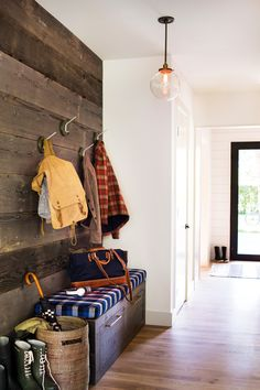 Mudroom with wooden plank wall