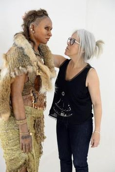 """exhibition reveals faces of prehistoric humans - Visual artist Elisabeth Daynes stands next to a reconstruction of """"The woman from the Pataud Shelter"""": Daynes started out as a make-up artist. But for 30 years now she has been recreating the faces and bodies of our ancestors from hominid fossils in her studio in eastern Paris."""