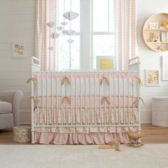 Pale Pink and Gold Chevron Crib Bedding | Carousel Designs.  Girly and feminine with a splash of glitz. This beautiful pale pink shade has just a hint of peach creating a soft and soothing feeling. The sparkling gold accents glam it up to the perfect level for your favorite little princess's nursery.