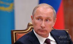 ベラルーシの首都ミンスク(Minsk)で会議に臨むロシアのウラジーミル・プーチン(Vladimir Putin)大統領(2014年8月26日撮影)。(c)AFP/RIA NOVOSTI/KREMLIN POOL/ALEXEI DRUZHININ