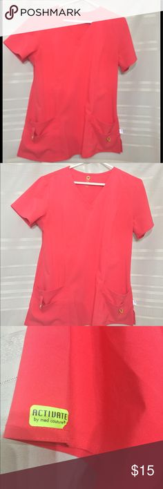 "Activate Med Couture Medical Scrub top sz L Coral Activate line by Med Couture Scrub Energy top sz L Coral No stains or holes or tears on garment. However, sight tear on label left sleeve (see pic). Looks like an ""iron on"" label separating. Not horrible- price reflects savings. Worn handful of times. No other signs of tearing on garment. Still beautiful and comfy. Note: compared to my other scrubs listed this one fits looser. You can definitely wear thick or thin tee shirts underneath. Tops…"