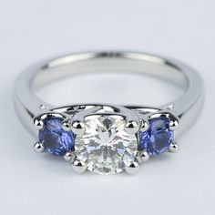 This trellis three-stone diamond and sapphire engagement ring makes the perfect 'something blue' for your wedding day and beyond. Two rich blue sapphires illuminate the round center diamond for added brilliance. Three Stone Engagement Rings, Three Stone Rings, Diamond Wedding Rings, Diamond Engagement Rings, Cinderella Engagement Rings, Vintage Engagement Rings, Ring Verlobung, Shopping, White Gold