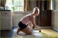 From Safe Haven, paint old wooden floor a happy color to brighten the place up:) Yellow.