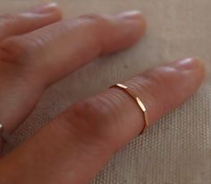 """Knuckle ring [aka memory, tea, and/or midfinger ring] with flattened, light-catching """"facets"""".  Also great as a pinkie ring.  14K rose gold-filled.  18 gauge.  Size 4, meant to be worn above the knuckle or on the pinkie.  Fixed size.  (FYI, the regular ring size that the ring is shown on is usu..."""