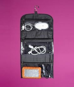 Hanging Wash Bag as Cord Storage | Store chargers, power cords, and extra headphones in the clear pouches of a hanging jewelry organizer. You'll be able to find exactly what you're looking for and packing your tech is that much easier.