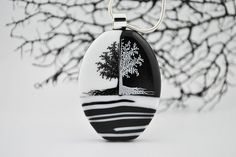 This Black & White fused glass pendant was created by Raya at RL Glass Art. Raya came up with this unique, amazing idea of using a pattern bar technique on the bottom of the glass to create interest to the piece.