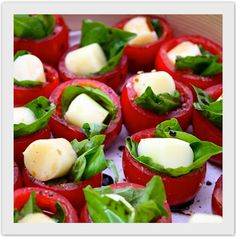 Party Food ~ Cut out centers of cherry tomatoes,add basil leaf, cut mozzarella sticks into bite size and place on basil.  Drizzle with olive oil & basalmic vinegar