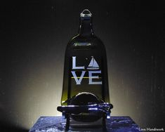 "You are looking at slumped (melted) bottle cheese board wall hanging with a ""Spread the Love"" labelled spreader knife. The bottle has ""LOVE"" etched on it, with a sailboat as the ""O"". These pieces are Wine And Liquor, Liquor Bottles, Glass Bottles, Slumped Glass, Fused Glass, Bottle Slumping, Wine Bottle Art, Recycled Bottles, Gifts For Wife"