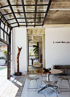 Retractable glass wall; terrace: http://www.marieclairemaison.com/data/photo/mw430_c18/dsc_0090.jpg ;  Jean-Marc Lederman