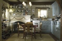 A fireplace in the kitchen? I love it. Cozy Kitchen